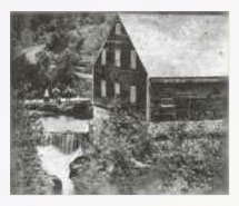 The mill built on the Sutton River by Lagrange around 1840. The waterfall is located slightly upstream of what is now Highland Street.